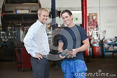 Business Customer Standing With Mechanic