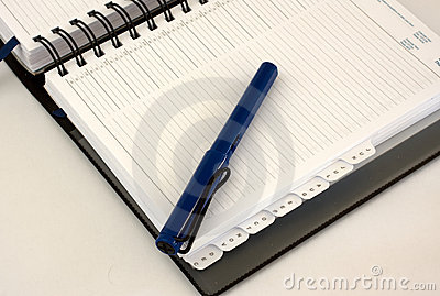 Business diary organiser with blue pen
