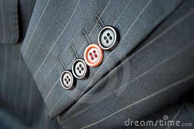 Business difference / Red suit button standing out