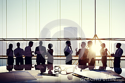 Business Discussing at Sunset Reflected onto Table