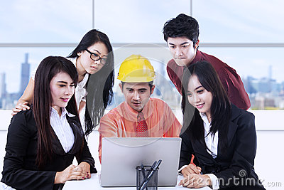 Business discussion with laptop