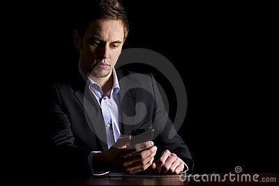 Business executive checking text messages