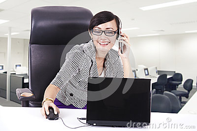 Business executive on phone with laptop