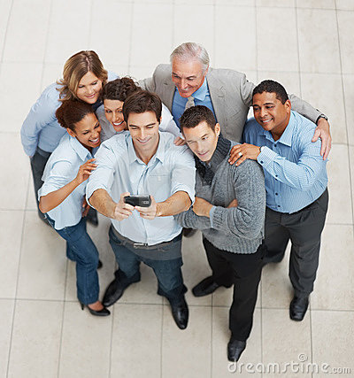 Business executives posing for a group photograph