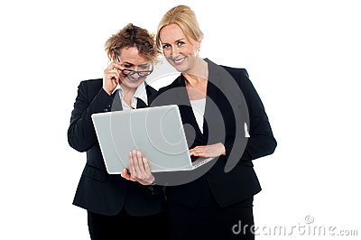 Business friends enjoying video on laptop
