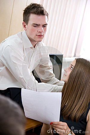 Business girl shows document to partner