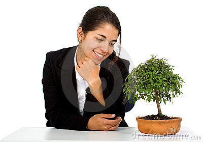 Business girl with a tree