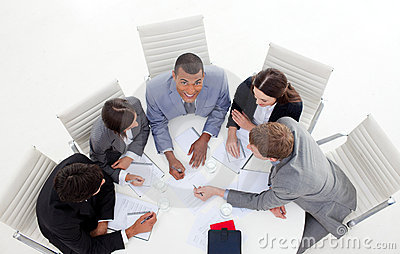 Business group sitting around a conference