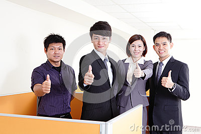 Business group smiles and showing thumb up