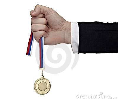 Business hand holding golden medal