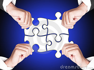 Business hands and puzzle