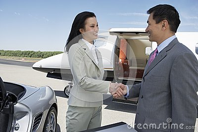 Business Handshake At The Airfield