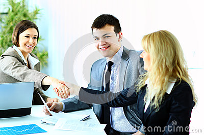 Business handshake after making