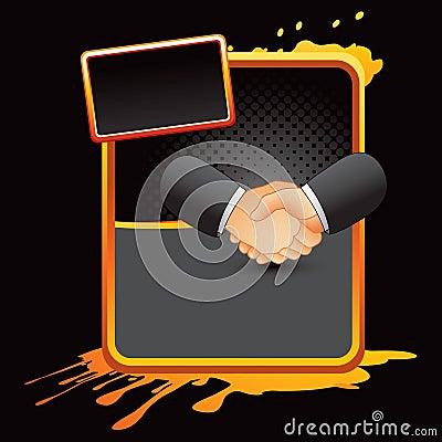 Business handshake on orange splattered banner