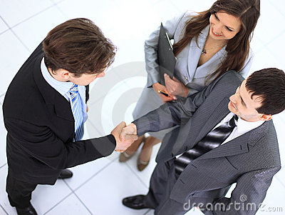 Business handshake and trust taken
