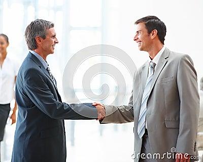 Business handshake between two men
