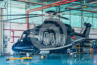 Business helicopter in hangar