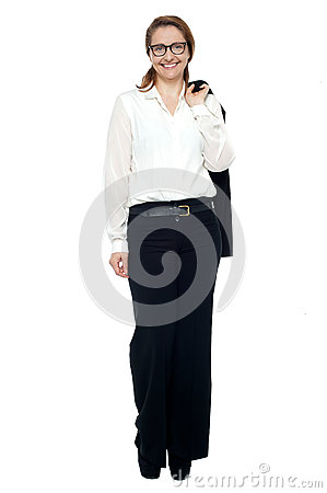 Business lady with coat slung over her shoulder