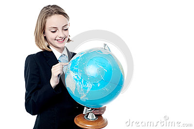 Business leader holding globe map