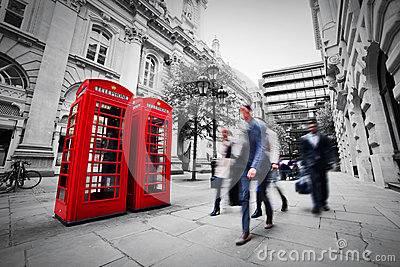 Business life concept in London, the UK. Red phone booth