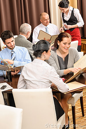 Business lunch executives look menu restaurant