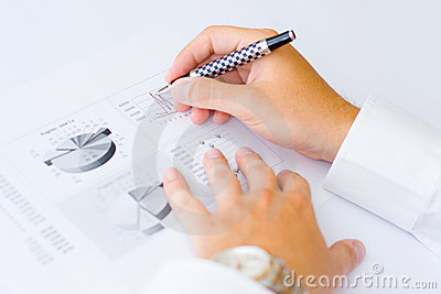 Business man analysing graph