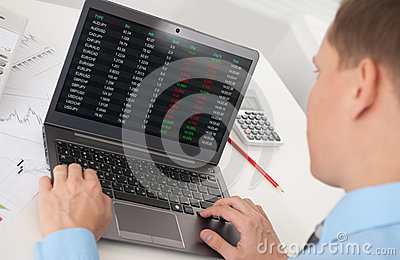 Business man analyzing the stock market