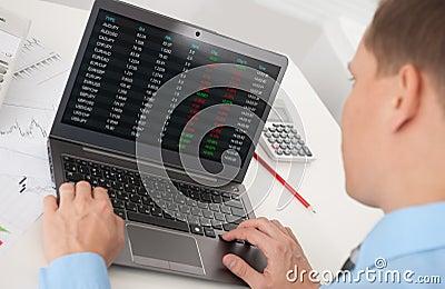 Business man analyzing the stock market