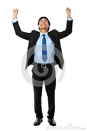 Business man with arms raised