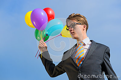 Business man with balloons