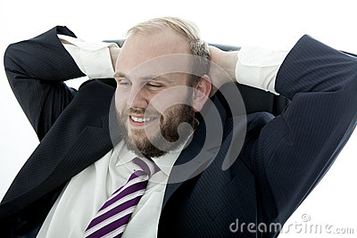 Business man with beard is happy and relaxing
