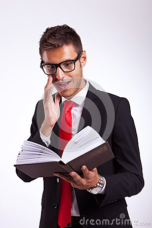 Business man being excited by the book