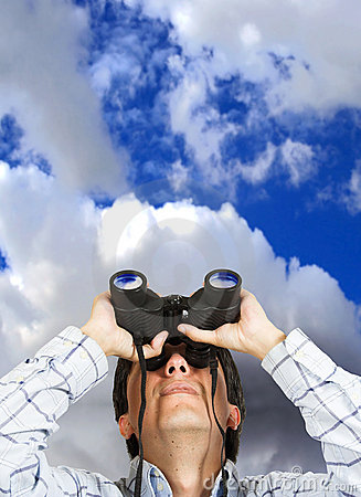 Business man with binoculars over sky