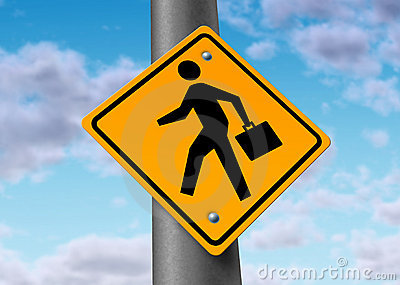 Business man with a brief case on a road sign
