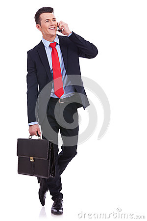 Business man with briefcase talking on the phone