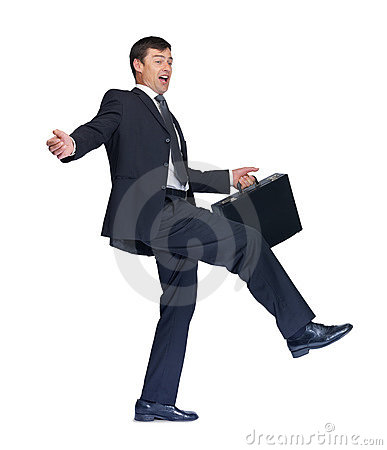 Business man with a briefcase about to fall