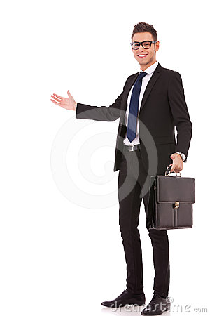 Business man with a briefcase welcoming