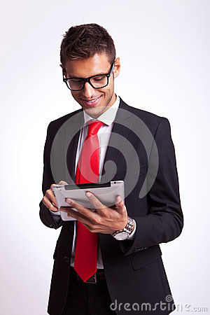 Business man browsing on his new tablet pad