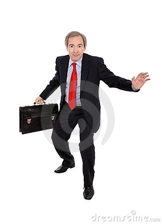 Business man carrying a briefcase