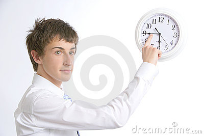 A business man changing the time on the office clo