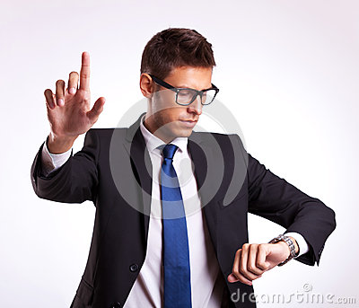 Business man checking time and pushing  button