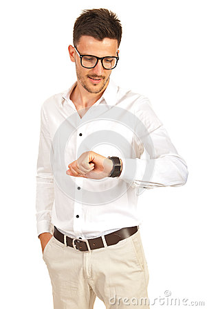 Business man checking wristwatch