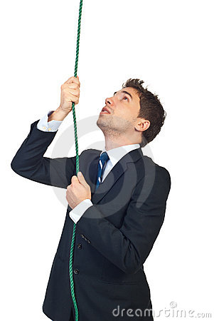 Business man climbing a rope