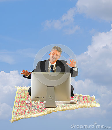 Business man with computer on a magic carpet ride