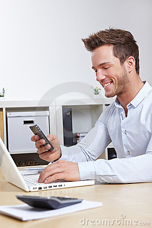 Business man connecting cell phone