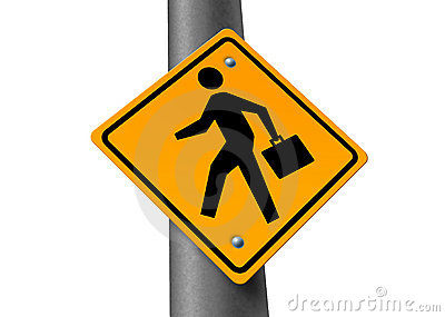 Business man crossing street sign