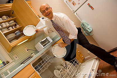 Business Man emptying dishwasher