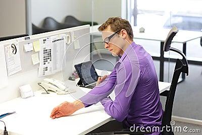 Business man exercising during work