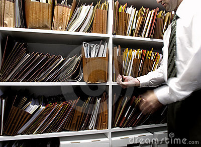 Business man files on shelf