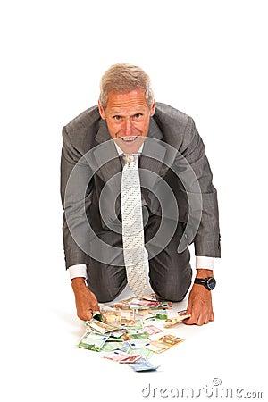 Business man finding euros
